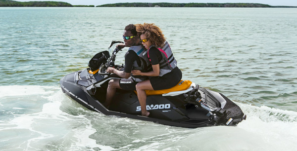 Couple riding a Sea-Doo Ppark with the Polytec Hull