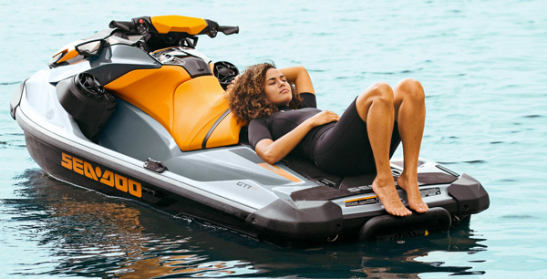 Woman relaxing on the Sea-Doo GTI SE large swim platform