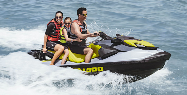 Family riding a Sea-Doo GTI SE with a Cargo box LinQ