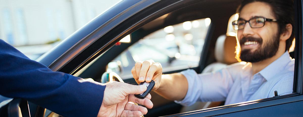 Man getting handed new car keys